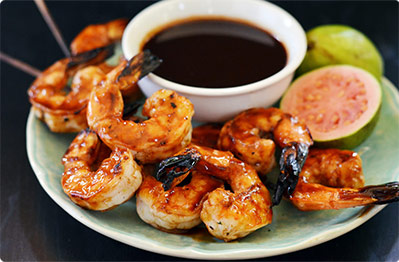 Chef Andrew Zimmern's Grilled Shrimp with Coconut Rice and Rum Glaze.